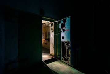 Blast door and fallout lock