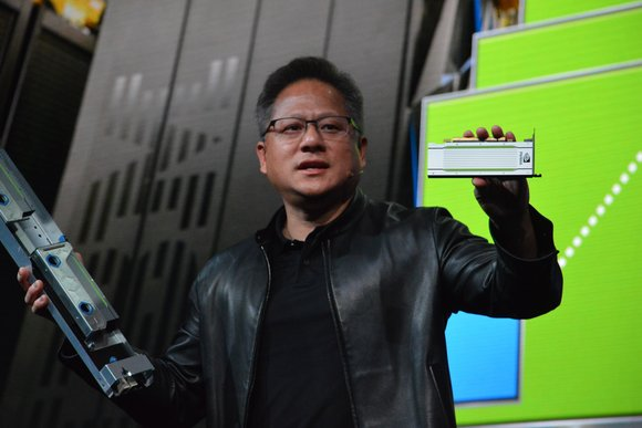 Nvidia CEO Jensen Huang holds a T4