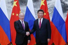 Russia's Putin and China's Xi Jinping shake hands