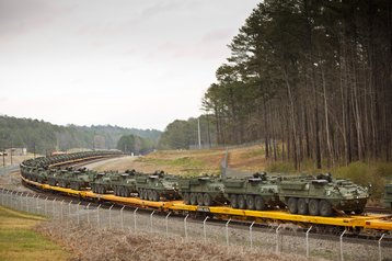 Stryker vehicles on a train