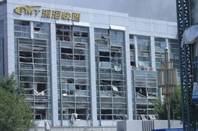 Building damaged in the Port of Tianjin explosion