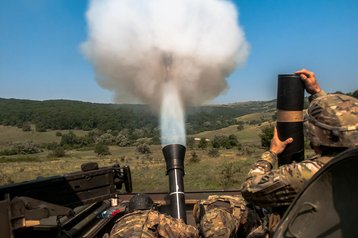 US Army fires a High Explosive 120mm mortar round during Exercise Saber Guardian 16